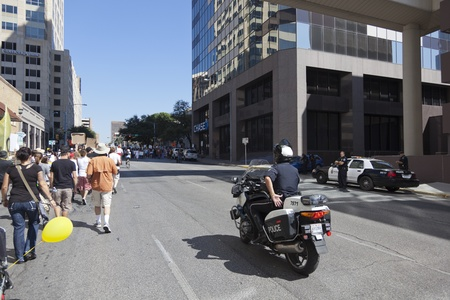 nonviolent: AUSTIN, TX - OCTOBER 15: An unidentified police officer directs traffic during the Occupy Austin march to the Texas State Capitol on October 15th, 2011 in Austin. Editorial