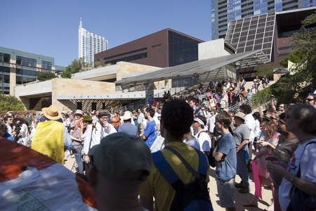 protestors: AUSTIN, TX - OCTOBER 15: A crowd of unidentified protestors gather at the general assembly in preparation for the Occupy Austin march to the Texas State Capitol on October 15th, 2011 in Austin.
