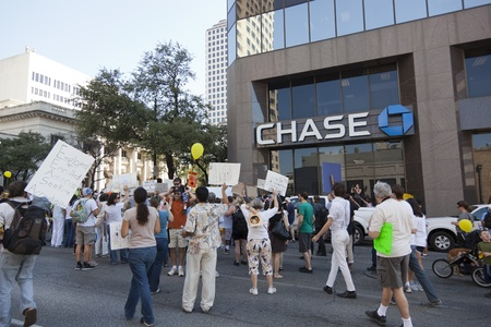 protestors: AUSTIN, TX - OCTOBER 15: An unidentified crowd of protestors gathers outside the Chase Bank Tower during the Occupy Austin march to the Texas State Capitol on October 15th, 2011 in Austin.