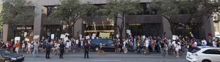 protestors: AUSTIN, TX - OCTOBER 15: An unidentified crowd of protestors pause outside the Chase Bank Tower during the Occupy Austin march to the Texas State Capitol on October 15th, 2011 in Austin.