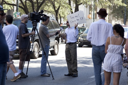 AUSTIN, TX - OCTOBER 15: An unidentified man answers interview questions during the Occupy Austin march to the Texas State Capitol on October 15th, 2011 in Austin.