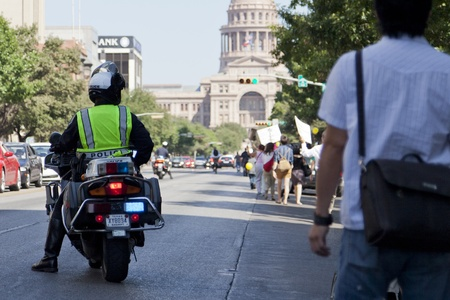 AUSTIN, TX - OCTOBER 15: An unidentified police officer directs traffic during the Occupy Austin march to the Texas State Capitol on October 15th, 2011 in Austin. Editorial