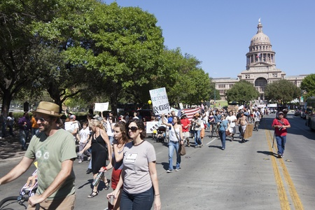 AUSTIN, TX - OCTOBER 15: An unidentified group of protestors carry signs down Congress Avenue during the 'Occupy Austin' march to the Texas State Capitol on October 15th, 2011 in Austin. Stock Photo - 10887881