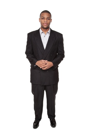 Isolated studio shot of a Confident African American businessman standing and looking directly at the camera. photo