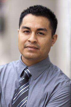 Stock closeup headshot photo of a Hispanic businessman.