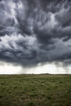 great plains: A rainstorm moving across the Great Plains in Central Wyoming
