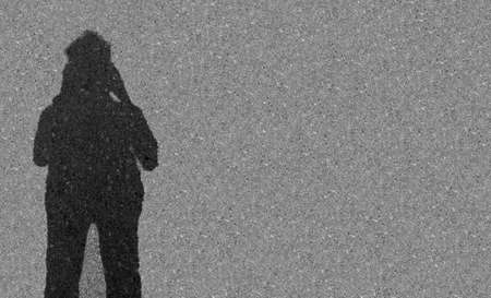 Shadow of a men on street background,Black and white tone. Abstract background and textures.