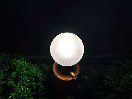 Lawn lamps are illuminated at night.Light of hope concept. Reklamní fotografie