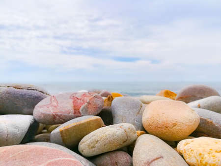 Stone and sea texture with cloudy day background.