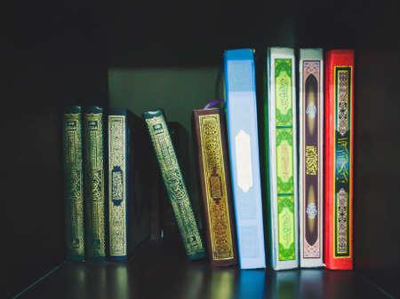 Quran on bookshelf. Stock Photo