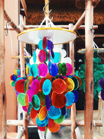Colorful of Mobile made from variety seashells hang on the wood.