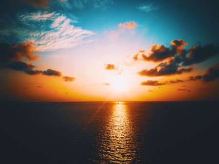 Golden time of sunset in the sea.