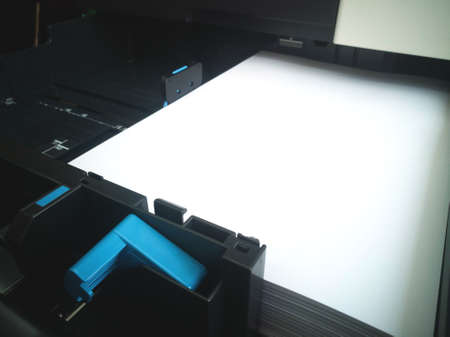 Paper in tray of printer.