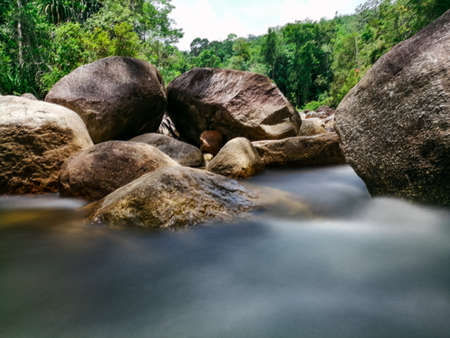 Beautiful long exposure stream in deep forest at Manora Waterfall, Phatthalung, Thailand. Stock Photo