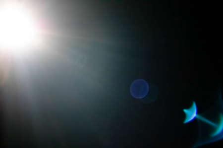 Close up soft light of smartphone flash. Blurred white light background.