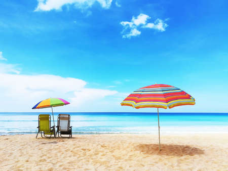 Colorful  umbrellas and chair on beach in vacation with beautiful blue sky and sea at Surin Beach, Phuket, Thailand.