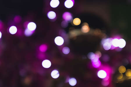 Abstract dark purple bokeh background in new year festival at Jungceylon, Phuket, Thailand.Night background and wallpaper concept.