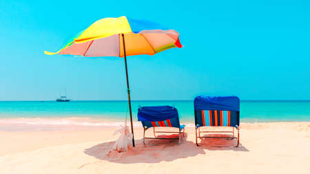 Umbrellas on the sandy beach and relaxing, beautiful scenery tropical landscape in summer vacation and travel in holiday. Stock fotó