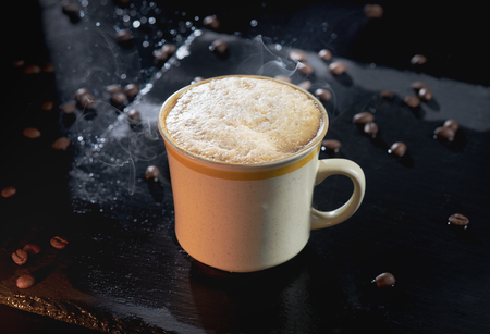 Hot Coffee with steam and coffee beans with dark background Stock fotó