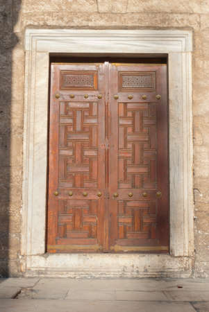 Wooden door with ancient floral patten  Wood carving technic photo