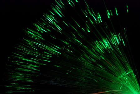 Fiber light in green and red on black photo