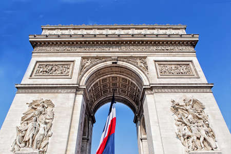 View from Arch of triumph with french flag in Paris, France photo