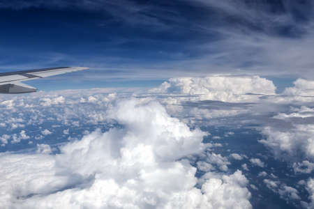 aileron: View over the clouds from the window of the plane