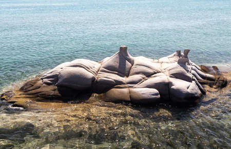 greece granite: PAROS, GREECE, AUGUST 26: Sculptured granite blocks Kolimbithres beach on August 26, 2014. Kolimbithres is one of the most famous beaches of Paros and is located in the huge bay of Naoussa.