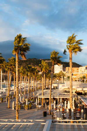 castle district: Photo of Coastal city of Malaga, Costa del Sol, Andalucia, Spain at sunset
