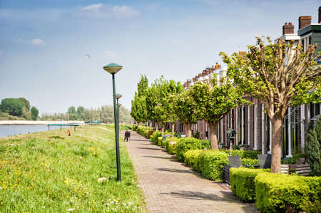neighbourhood: Small traditional houses in the Lekkade Neighbourhood of Kinderdijk Stock Photo