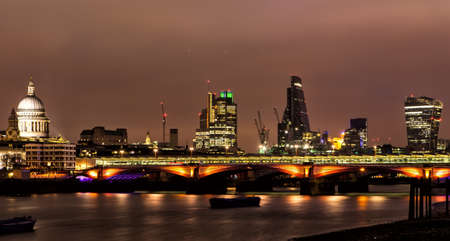 LONDON - JANUARY 1: City of London and St Paul cathedral at night on January 1, 2015. The City is a tiny part of the metropolis of the London region. It holds city status in its own right.