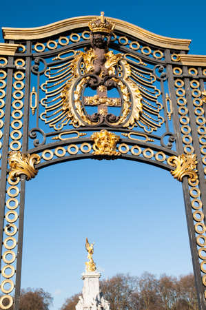 Gate with gilded ornaments in Buckingham Palace. Buckingham Palace is a symbol and home of the British monarchy.