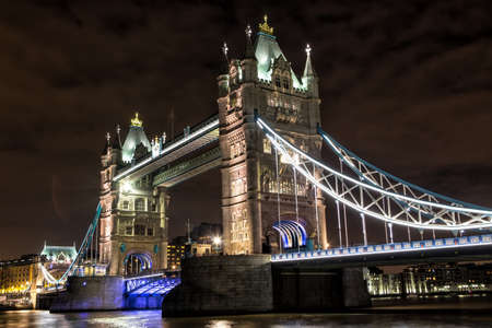LONDON - DECEMBER 31: Tower Bridge at night on December 31, 2014. Tower Bridge (built 1886-1894) is a combined bascule and suspension bridge in London which crosses the River Thames. Editorial
