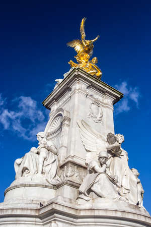 London, United Kingdom: January 20, 2015 - The Victoria Memorial is a monument to Queen Victoria, located at the end of The Mall in London, and designed and executed by the sculptor Thomas Brock.