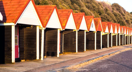 BOURNEMOUTH, UNITED KINGDOM – DECEMBER 23: Beach huts on December 23, 2014. Beach huts have been a prominent feature of the seafront at Bournemouth since the 1930s.