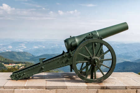 A old cannon steel with mountain background image