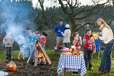 social drinking: Family bonfire with food and drinks Stock Photo
