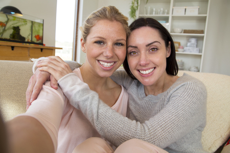 homosexual sex: Same sex female couple taking a selfie in their home Stock Photo