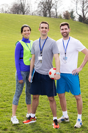 Small group of PE teachers smiling for a portrait Stock Photo