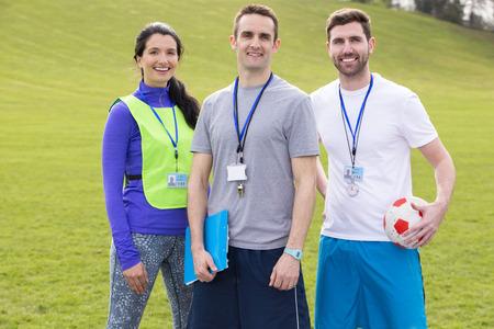 Small group of PE teachers smiling for a portrait Standard-Bild