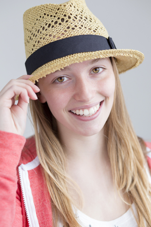 teenage girl: Teenage girl posing for the camera with a summer hat Stock Photo