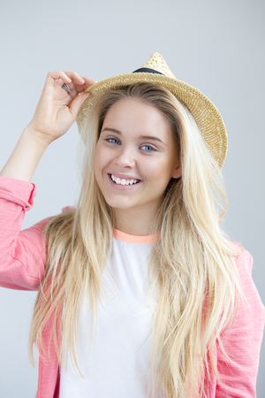 eyes hazel: Teenage girl posing for the camera with a summer hat Stock Photo