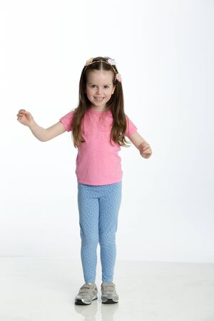 arms out: Young girl posing for the camera with her arms out.