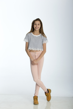 blond girl: Full length portrait of a young girl against a white background.