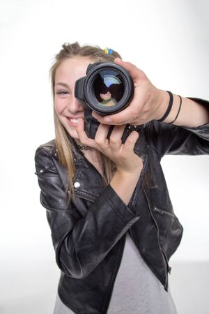 hand job: Teenage girl taking a photo with a camera
