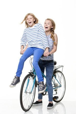 people walking white background: Sisters on a bike