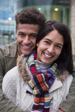 love hug: Attractive young couple posing together in the city