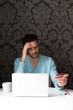 banking problems: Young man having problems with internet banking Stock Photo
