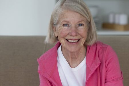 senior women: Portrait of a senior woman. She is smiling and looking at the camera. Stock Photo