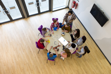 Ariel view of students and teachers in a Design and Technology lesson.